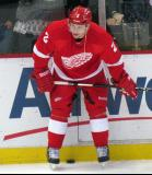 Brendan Smith crouches along the boards during pre-game warmups.