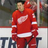 Jordin Tootoo stands along the boards during pre-game warmups.