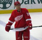 Gustav Nyquist stands at the blue line, laughing, during pre-game warmups.