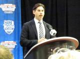 Mathieu Schneider, former Red Wing and Special Assistant to the Executive Director of the NHLPA, speaks from the podium during the 2014 Winter Classic announcement press conference.