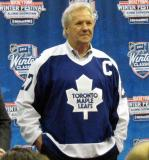 Darryl Sittler displays the jerseys to be worn in the Alumni Showdown prior to the 2014 Winter Classic at the announcement press conference.