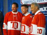 Joe Kocur, Kris Draper and Mickey Redmond show off the Detroit Red Wings' Alumni Showdown jerseys at the 2014 Winter Classic announcement event.
