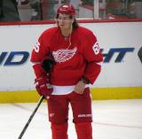 Danny DeKeyser stands in the neutral zone during pre-game warmups.