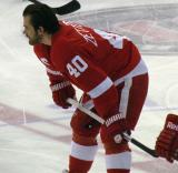 Henrik Zetterberg crouches near center ice during pre-game warmups.