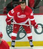 Henrik Zetterberg crouches along the boards during pre-game warmups.