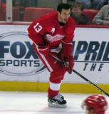 Pavel Datsyuk carries a puck along the boards during pre-game warmups.