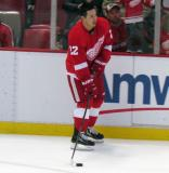 Jordin Tootoo carries a puck along the boards during pre-game warmups.