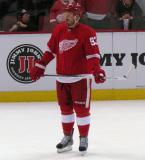 Johan Franzen stands in the neutral zone during pre-game warmups.