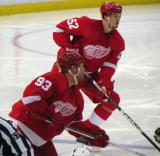 Johan Franzen and Jonathan Ericsson react off a faceoff.
