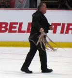 Al Sobotka twirls an octopus that was thrown onto the Joe Louis Arena ice.