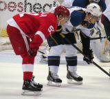 Valtteri Filppula gets set for a faceoff opposite Alexander Steen of St. Louis.