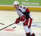Jeff Hoggan skates with the puck during pre-game warmups before a Grand Rapids Griffins game.