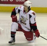 Mitch Callahan kneels on the ice during pre-game warmups before a Grand Rapids Griffins game.
