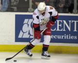 Francis Pare carries a puck along the boards during pre-game warmups before a Grand Rapids Griffins game.