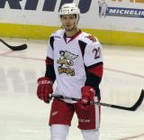 Gleason Fournier stands near the left faceoff circle during pre-game warmups before a Grand Rapids Griffins game.