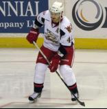 Brennan Evans stands at the left faceoff dot during pre-game warmups before a Grand Rapids Griffins game.