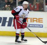 Chad Billins looks to make a pass during pre-game warmups before a Grand Rapids Griffins game.