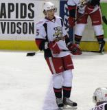 Adam Almquist stands at the blue line during pre-game warmups before a Grand Rapids Griffins game.