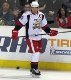 Jeff Hoggan skates along the boards during pre-game warmups before a Grand Rapids Griffins game.