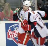 Riley Sheahan takes a drink of Gatorade during pre-game warmups before a Grand Rapids Griffins game.