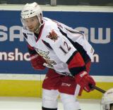 Brent Raedeke crouches during pre-game warmups before a Grand Rapids Griffins game.
