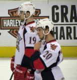 Riley Sheahan and Gleason Fournier stand near the blue line during pre-game warmups before a Grand Rapids Griffins game.
