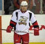 Francis Pare stands near the boards during pre-game warmups before a Grand Rapids Griffins game.
