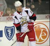 Luke Glendening looks to make a pass during pre-game warmups before a Grand Rapids Griffins game.