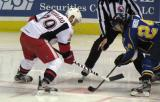 Landon Ferraro takes a faceoff against Anthony Nigro of the Peoria Rivermen during a Grand Rapids Griffins game.