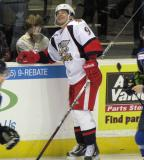 Francis Pare leans against the boards during a stop in play in a Grand Rapids Griffins game.
