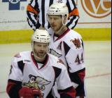 Brett Skinner and Brennan Evans skate during a stop in play in a Grand Rapids Griffins game.