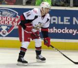 Chad Billins gets set for a faceoff during a Grand Rapids Griffins game.