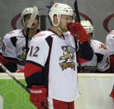 Brent Raedeke stands at the bench during a stop in play in a Grand Rapids Griffins game.