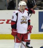 Riley Shehan waits for a faceoff during a stop in play a in Grand Rapids Griffins game.