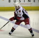Chad Billins plays the puck at his own blue line during a Grand Rapids Griffins game.
