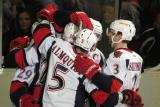 Landon Ferraro, Tomas Jurco, Adam Almquist, Jeff Hoggan and Brett Skinner celebrate a goal by Ferraro during a Grand Rapids Griffins game.