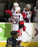 Landon Ferraro celebrates a goal at the bench with Gleason Fournier and Chad Billins during a Grand Rapids Griffins game.