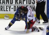 Mitch Callahan takes down Stefan Della Rovere of the Peoria Rivermen in a fight during a Grand Rapids Griffins game.