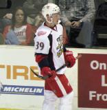 Jan Mursak skates back to the bench during a stop in play in a Grand Rapids Griffins game.