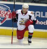 Chad Billins kneels on the ice prior to the start of the third period of a Grand Rapids Griffins game.