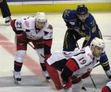 Tomas Tatar lines up across from Andrew Murray of the Peoria Rivermen on the opening faceoff of the third period, to be taken by Riley Sheahan for the Grand Rapids Griffins.