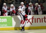 Francis Pare celebrates a goal in a Grand Rapids Griffins game, skating past Tomas Jurco, Landon Ferraro, Triston Grant, Mitch Callahan and Brent Raedeke on the bench.