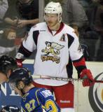 Brennan Evans stands along the boards before a faceoff in a Grand Rapids Griffins game.