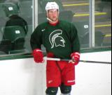 Justin Abdelkader stands along the boards during a session of the 2013 MSU Pro Camp.