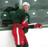 Justin Abdelkader leans on the boards during a session of the 2013 MSU Pro Camp.