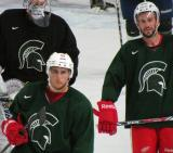 Valtteri Filppula and Drew Miller skate back to the bench during a session of the 2013 MSU Pro Camp.