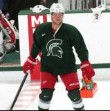 Justin Abdelkader carries some Gatorade across the ice during a session of the 2013 MSU Pro Camp.