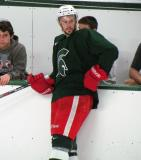 Drew Miller leans on the boards during a session of the 2013 MSU Pro Camp.