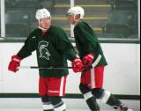 Justin Abdelkader and Valtteri Filppula skate during a session of the 2013 MSU Pro Camp.