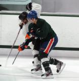 Bryan Lerg and Jeff Petry battle for the puck during a session of the 2013 MSU Pro Camp.